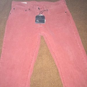 511 Levi skinny jeans. Brick color.